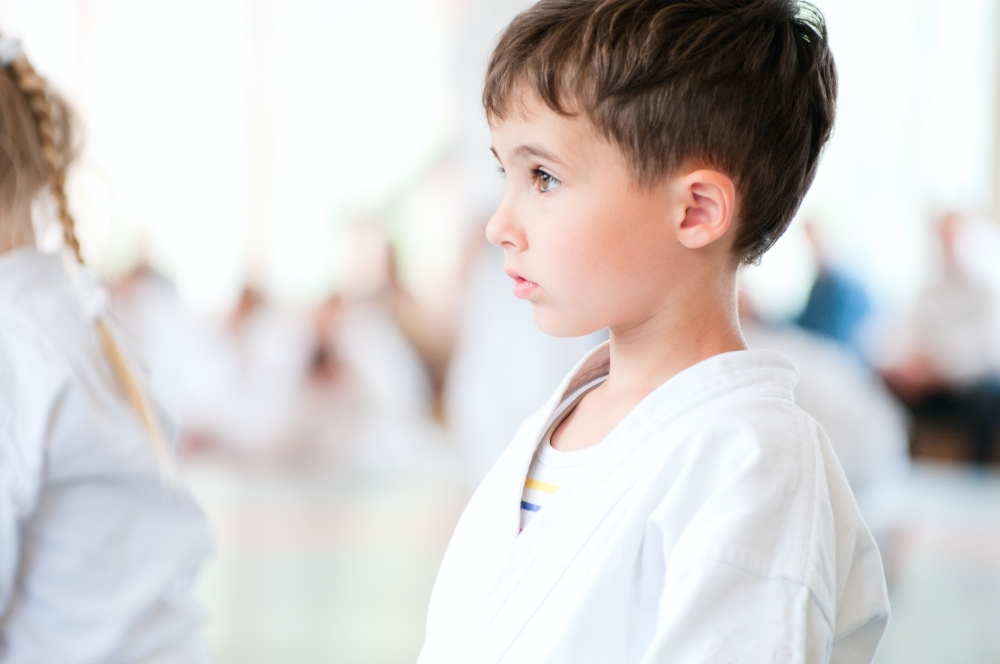 Karate children training in sport hall
